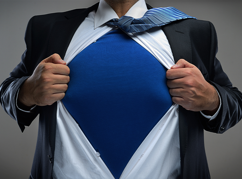 man posing as a superhero with a blue shirt showing at his chest