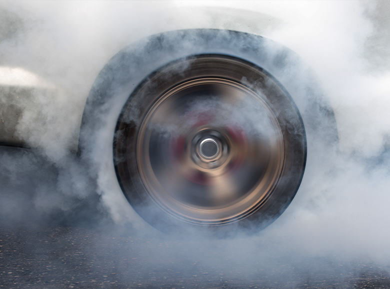 wheel smoking from a burnout