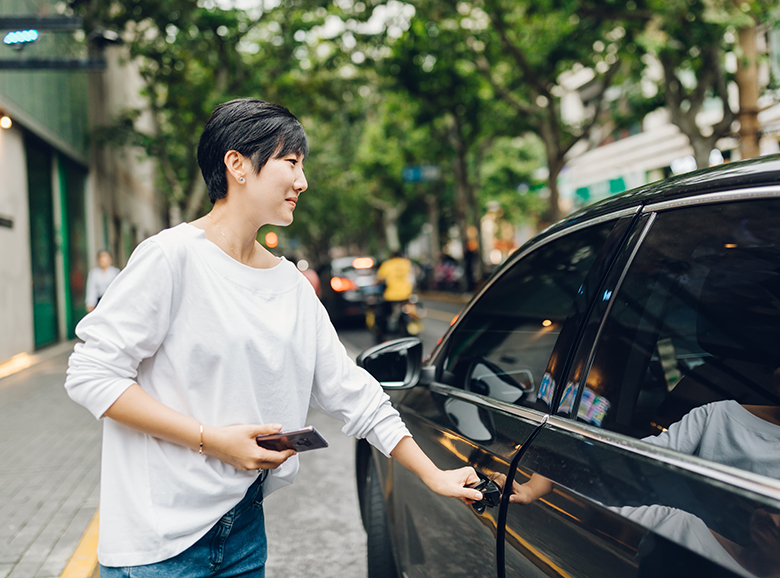 Woman getting into a rideshare
