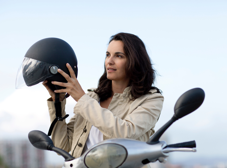 Woman putting helmet on