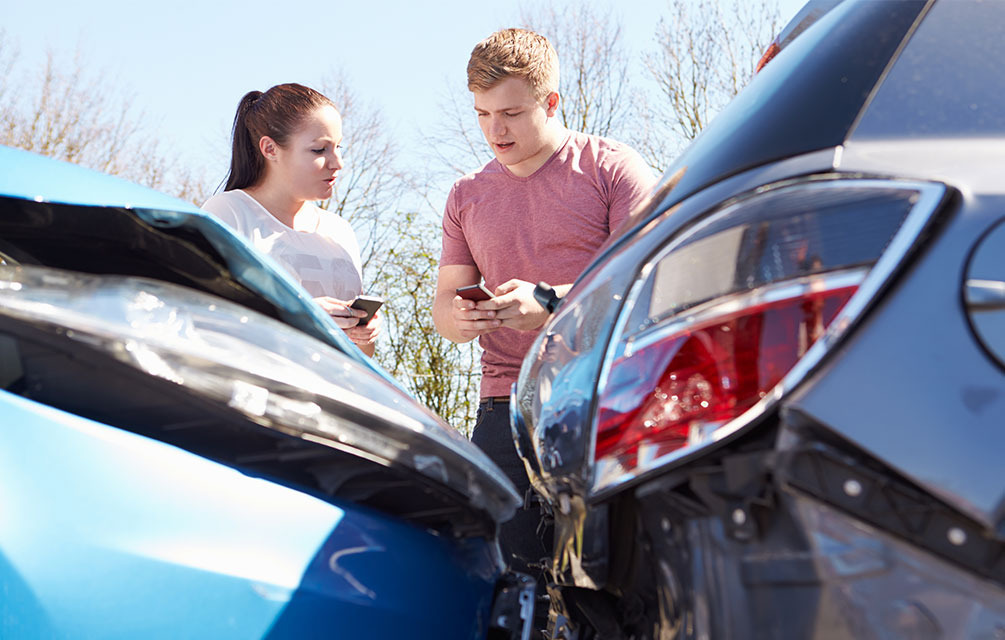 two people exchanging details after an accident