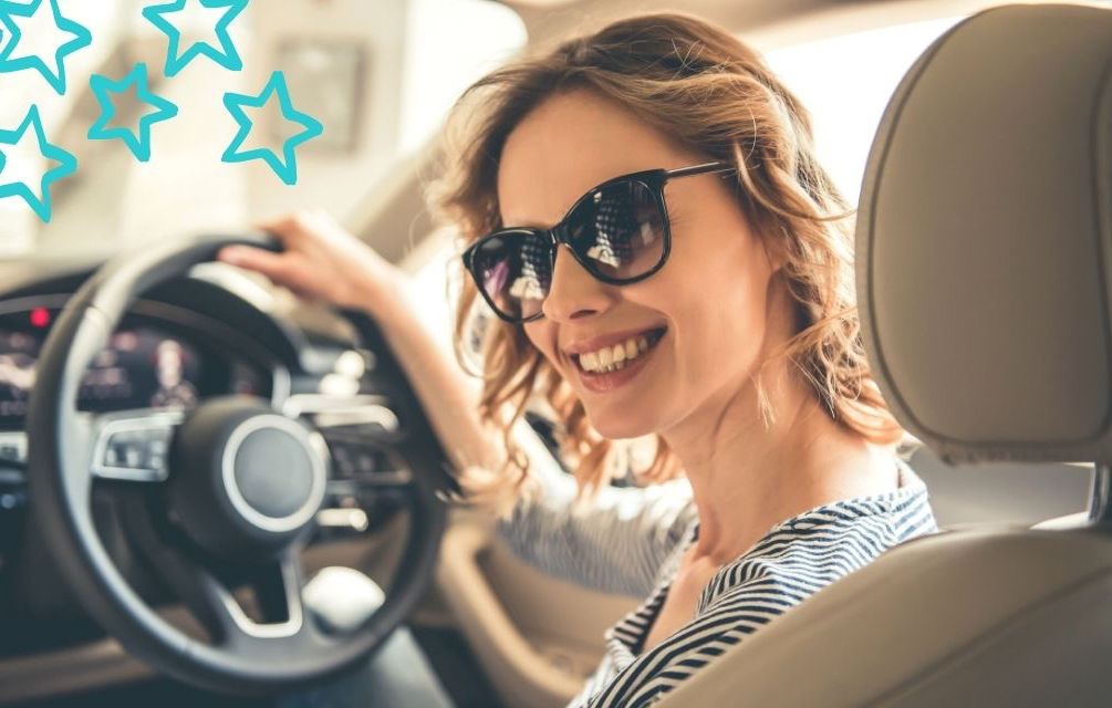 Lady sitting in car smiling